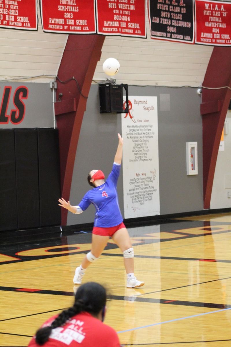 Photo by George Kunke - Willapa Valley junior Merissa Frasier lets fly with a serve against Raymond Saturday afternoon at Seagull gym.