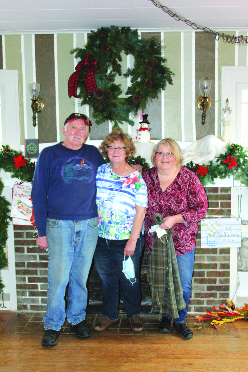 Photo by George Kunke - Les and Lynne Goodwin have decided to retire after 39 years in the floral and gift shop business. Nancy Germeaux (right) worked at Flowers by Lynne for 28 years.