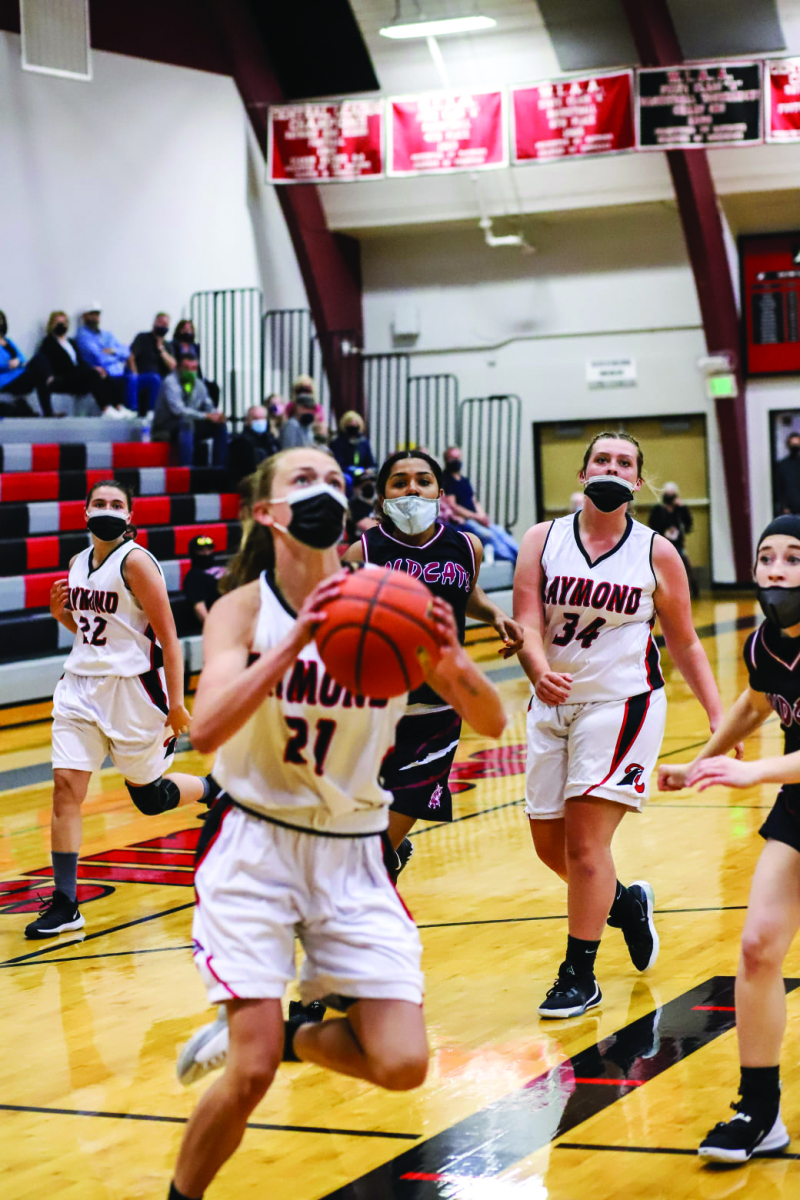Photo Courtesy Larry Bale - Raymond HS junior Kyra Gardner scored her 1,000th point last Tuesday night (May 4) at Seagull gym.