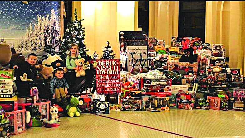 Photo from Derik Nissel Toy House Facebook - The collection of toys from 2018 with Derik's niece and nephews. From left to right are Grayson Dickey, Steven Nissell, and Lilly Nissell.